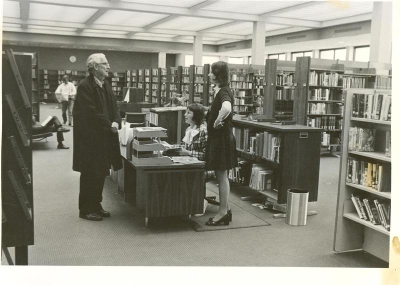 Patron Talking to Librarians, 1972
